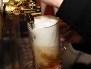 Draft beer being poured into a glass