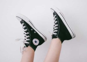 pair of converse shoes & legs upside down | walk in your reader's shoes