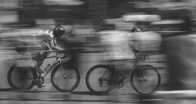Racing Bicyclists—Life going by in a blur