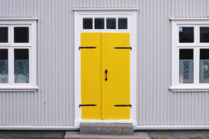 Bright yellow door with steps
