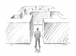 line drawing of Business person at entrance to a maze
