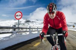 Bicyclist riding in the snow without distractions