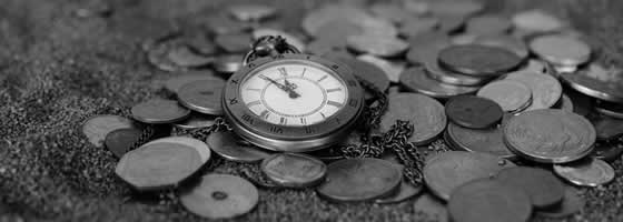 pocket watch on a pile of old coins | Save time and money