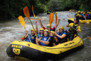 Rafting paddles in air for a high-five